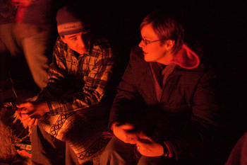 my friends Aaron and Sonja sitting by the fire, faces lit with the firelight